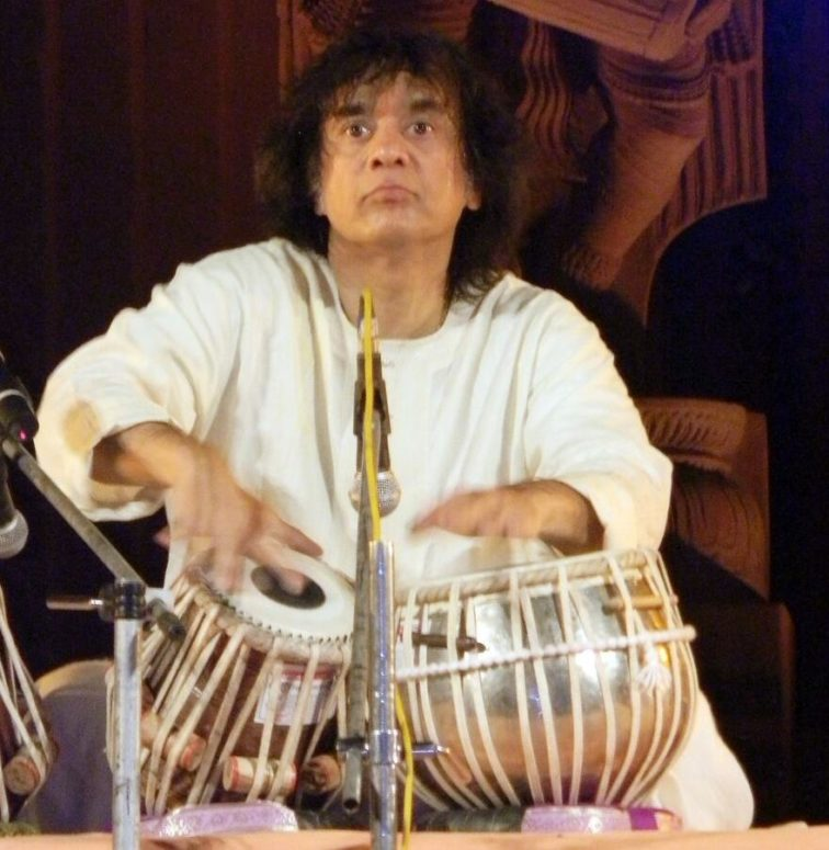 Zakir Hussain plays the tabla