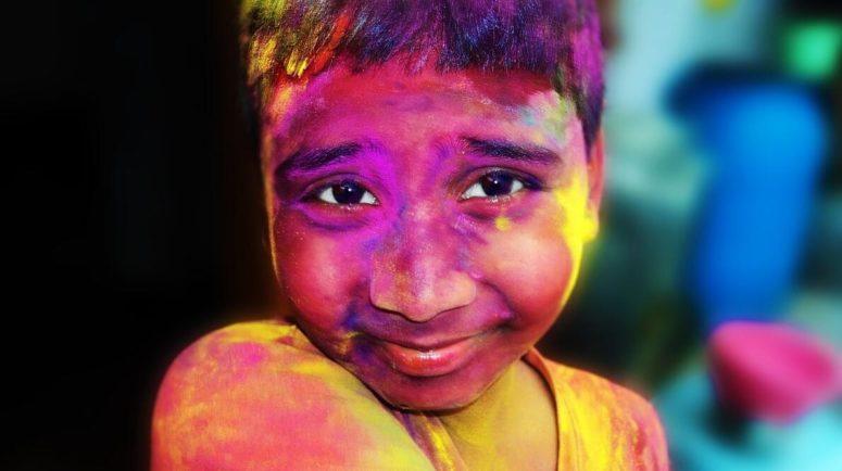 Boy celebrating the Hindu holiday Holi