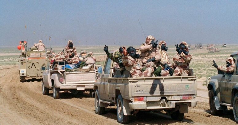 Kuwaiti troops drive through southern Kuwait during Operation Desert Storm