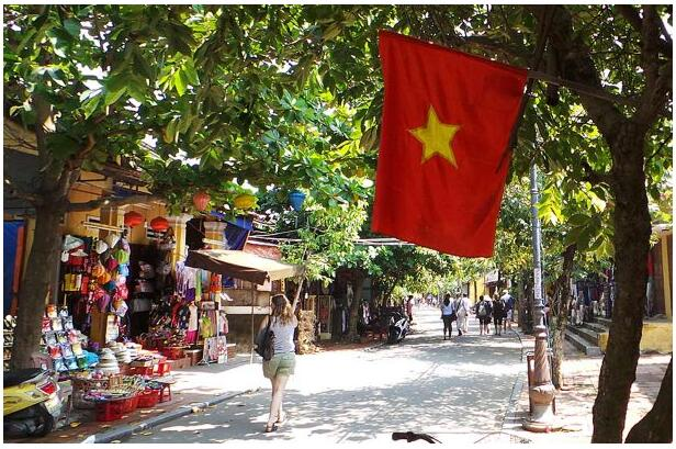 The street scene in Hoi An is colorful and green