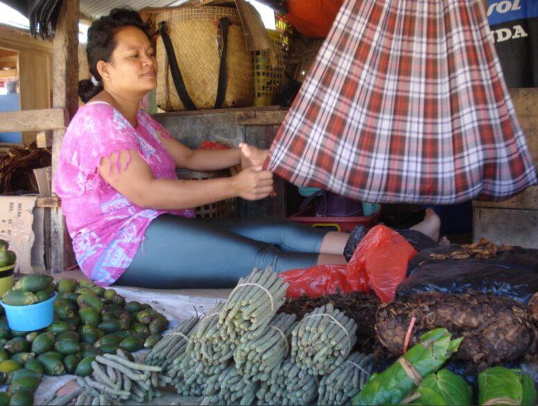 Market vendor with child